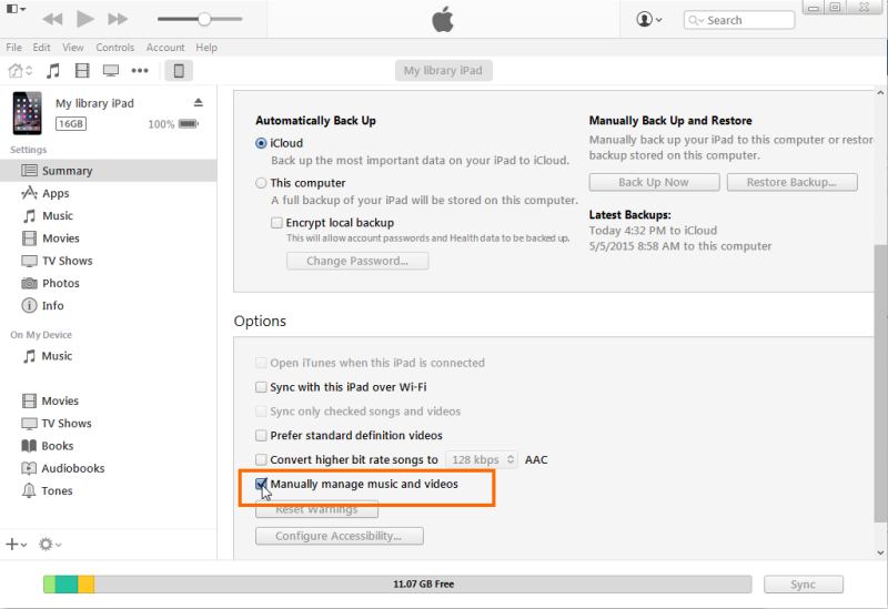 iTunes window with Manually manage music and videos selected. See instructions above.